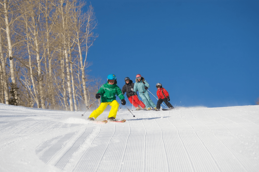 family skiing deer valley