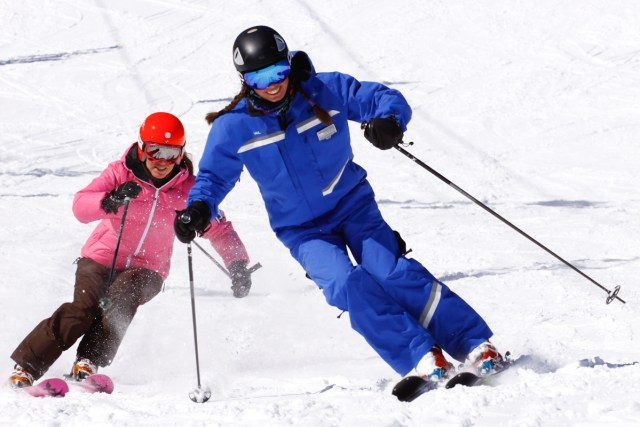 beaver creek instructor skiing with woman
