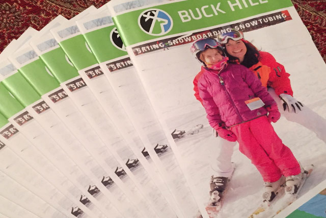 cover of the buck hill minnesota learn to ski brochure with a mom and daughter