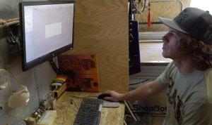 slant skis founder josh bennett using a computer to design skis