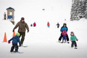family skiing at ski showdown montana
