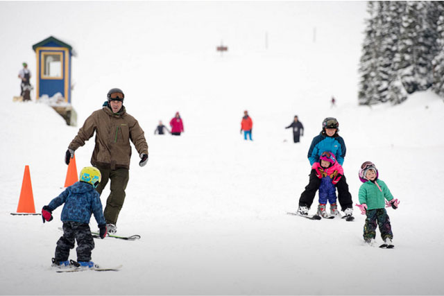 family skiing at ski showdown montana
