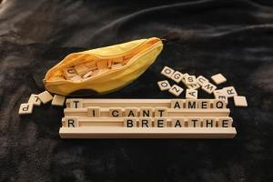 """Bananagrams rack with the words """"I can't breathe"""" spelled out in tiles"""