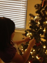 Aileen decorating the tree