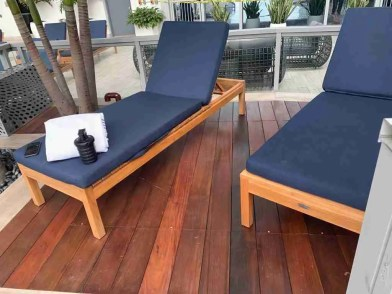 A royal blue lounge chair sitting on top of an ipe wood deck in Wellington.