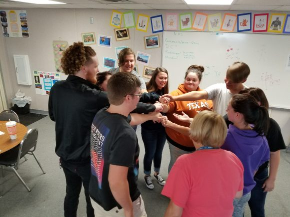 Brazos River Charter School Students Performing Teamwork Exercises