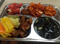 Rice, fish and radish stew, peppers dipped in ssamjang, kimchi x2, watermelon, seaweed and shellfish soup, mystery veg gochujang salad