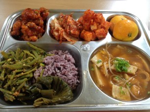 Ganjang fried....chicken?, kimchi, citrus, fish cake soup, rice, mystery stems salad, pickled peppers and perilla leaves