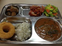 Hella tasty stewed pork, kimchi, zucchini salad, rice, donut that was v nice, and chueotang