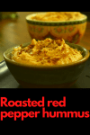 Bowl of delicious red pepper hummus