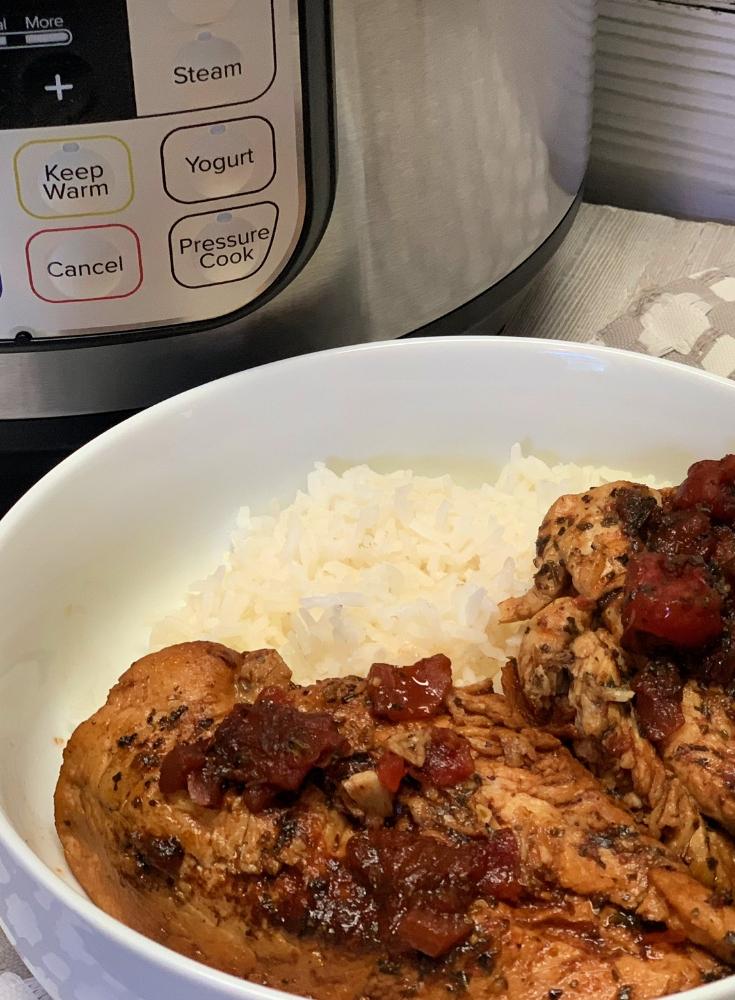 bruschetta chicken in a bowl with rice