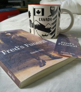 Books and a mug on a bed