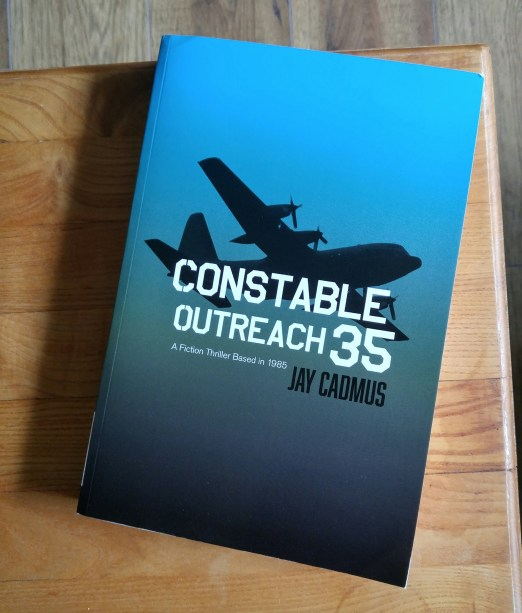 Constable Outreach 35 book by Jay Cadmus lying on a coffee table