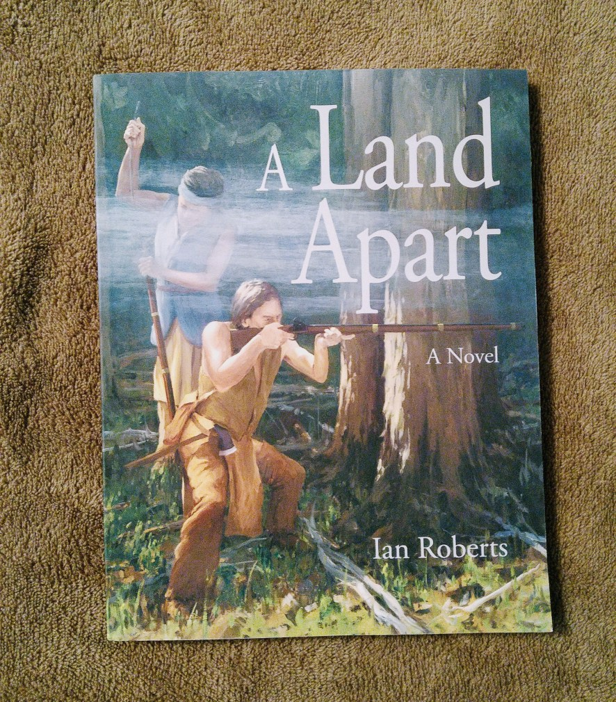 A Land Apart book lying on a blanket