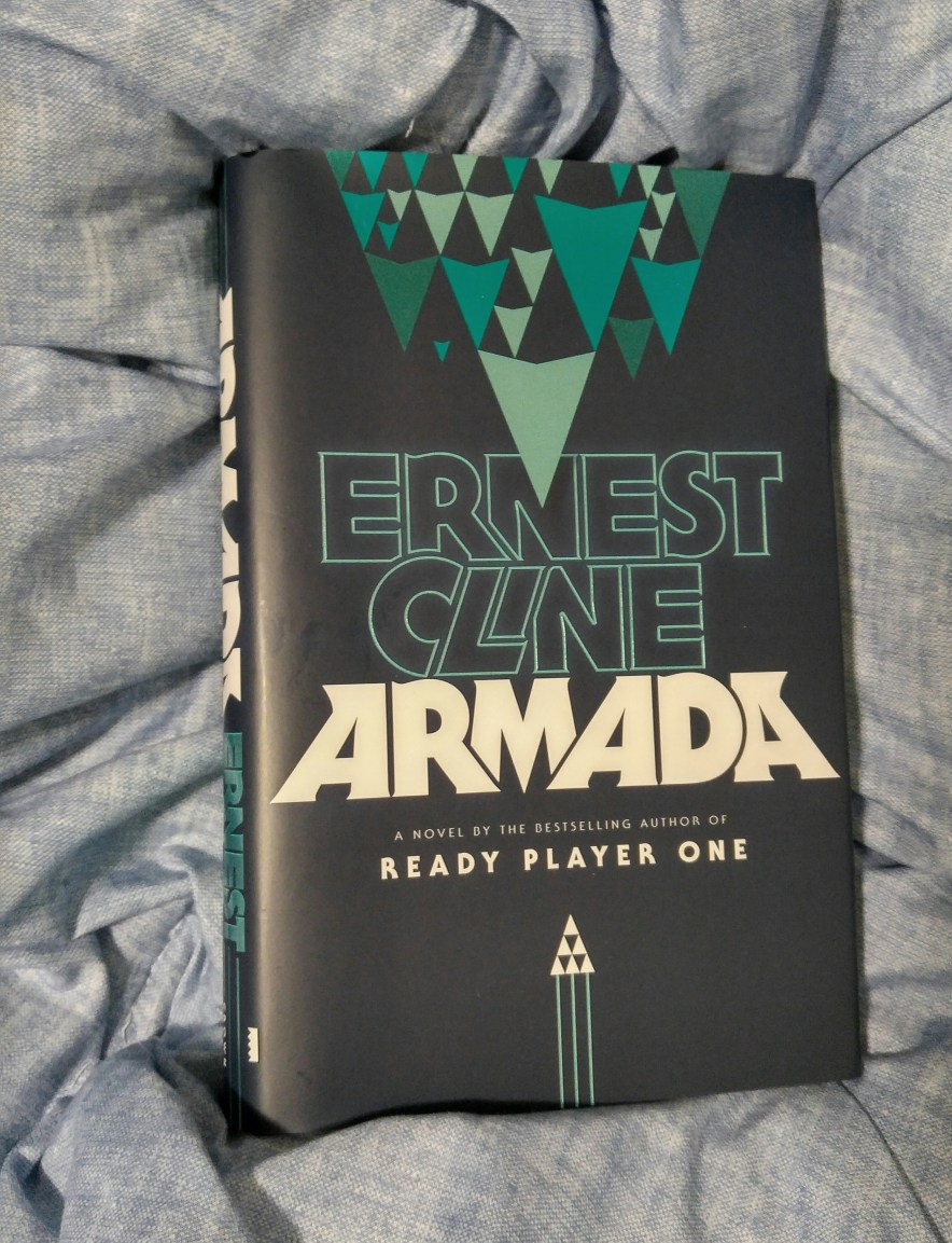 The book Armada by Ernest Cline on a bed
