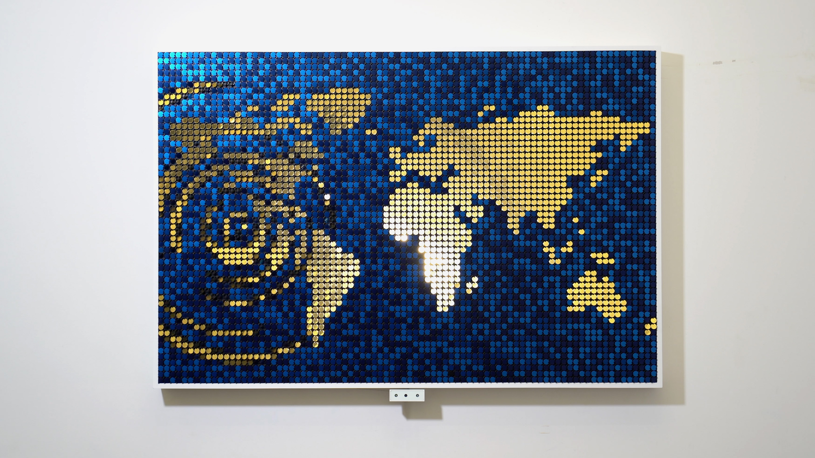 Blue and gold Flip-Discs artwork called Seismic Echo showing a map with real-time seismic activity overlaid. Created by BREAKFAST.