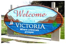 Victoria sign showing Lisa Helps gets greener (more bud) Victoria, by Hal Hannon