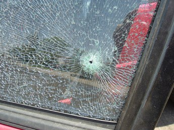 bullet hole in car window