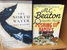 The North Water by Ian McGuire, Pushing up Daisies by M.C. Beaton