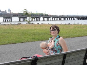 One of our NJ mommas nursing in public with Liberty Island in the background.