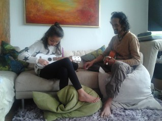 Uncle and niece learning ukulele in Cologne