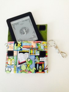 Photo of my custom Kobo case, with bookworm fabric and my Kobo peeking out