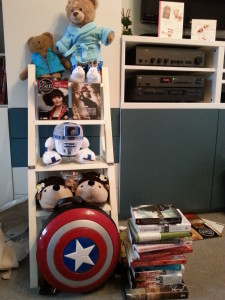 Photo of my gifts all together, including a stack of books and a shield backpack