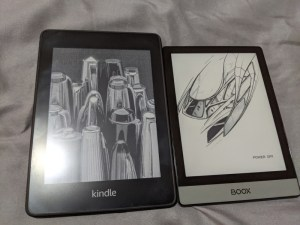 Kindle Paperwhite on the left, compared with an Onyx Boox Poke2 on the left. Screen up.