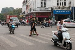 Shane and Loretta crossing a road in Hanoi