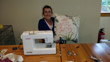 Scotland, Susan happy on a sewing machine.