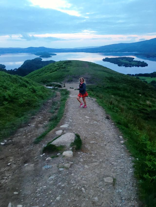Photo shows Jagoda running along a path with views of Loch Lomond during the West Highland Way Race