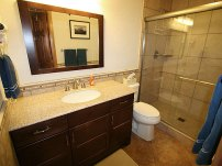 The bathroom on the main floor has a large stand-up shower with sink area and hair dryer.