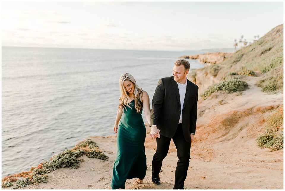 man and woman walking during their Sunset Cliffs Engagement Session