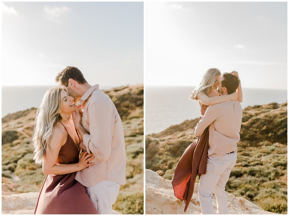 man picks up his fiance and kisses her during their engagement photos at torrey pines gliderport in San Diego, California
