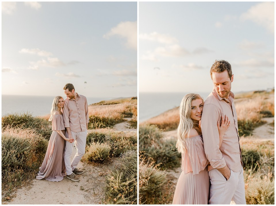 romantic pictures of a couple holding hands at torrey pines gliderport. engagement pictures by bree and stephen photography