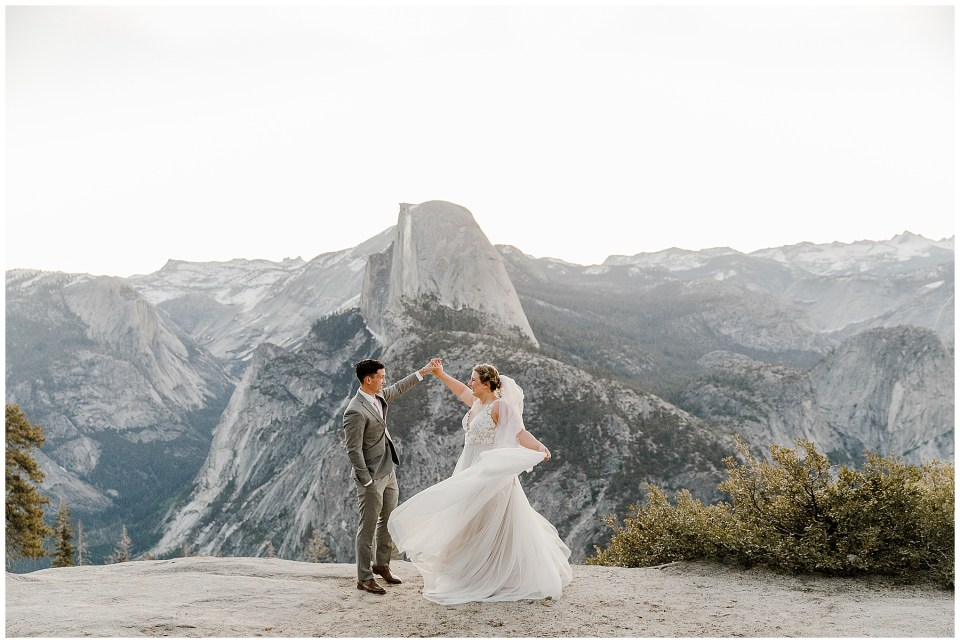 bride and groom dancing at glacier point