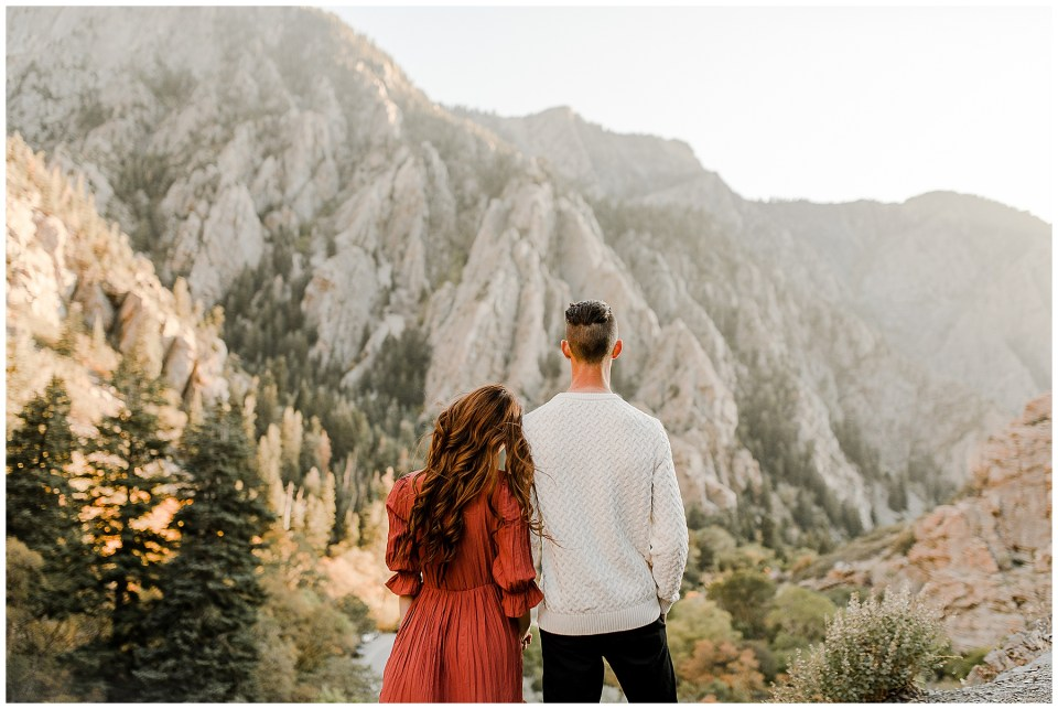 couple holding hands and looking at the view during their Big Cottonwood Canyon Engagement Session