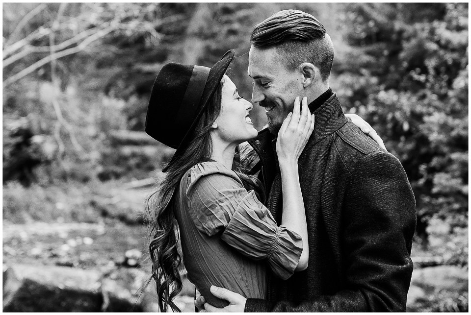 Man and woman kissing in the forest during their Big Cottonwood Canyon Engagement Session