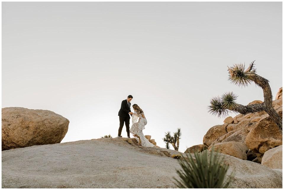 bride and groom in desert of california