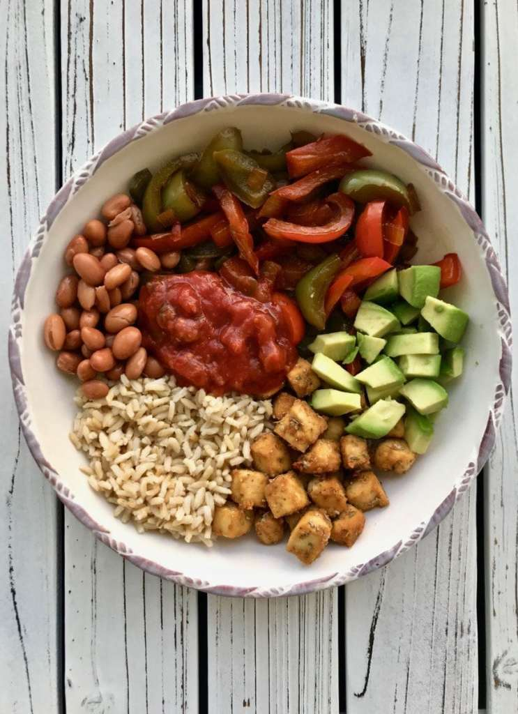 Vegan bowl recipe - veggies, rice, beans, tofu.