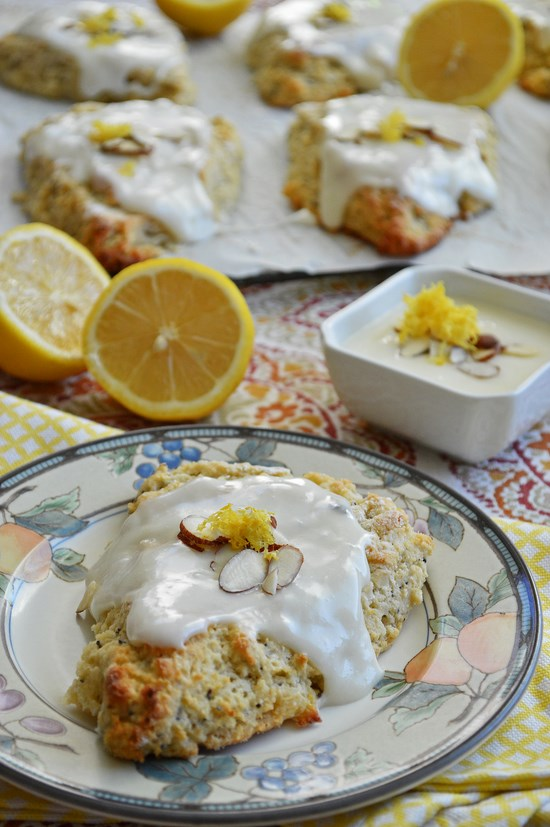 Light and buttery gluten free lemon scones speckled with poppyseeds and topped with a lemon cream cheese glaze.