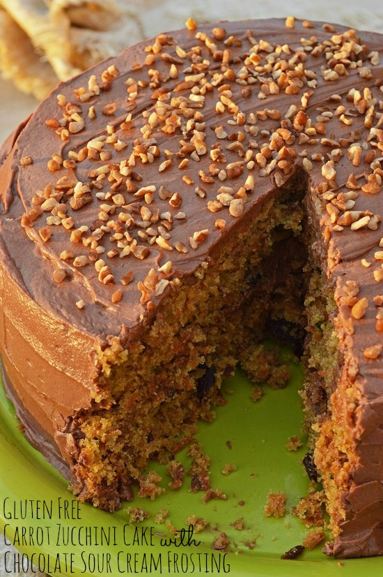 The best ever carrot cake that just so happens to be gluten free. Filled with carrots, raisins, and pecans and flavored with cinnamon and nutmeg. Topped with a smooth sour cream chocolate frosting.