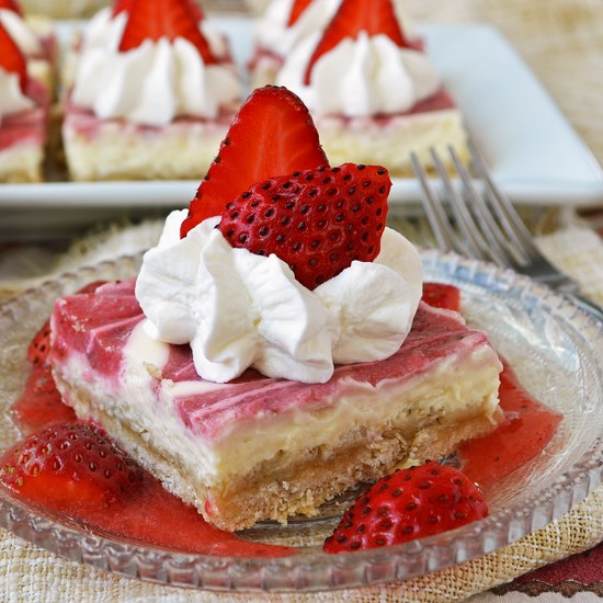 A lower fat strawberry cheesecake filling made with cream cheese, Greek yogurt, and cottage cheese baked on top of a buttery oatmeal crust.