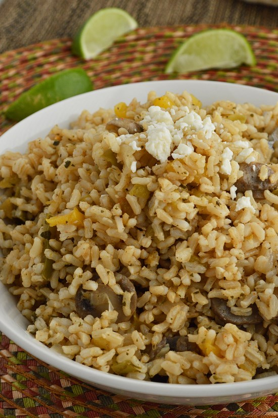 A quick gluten free side dish made in minutes with Minute brown rice. Jazzed up with bell peppers, mushrooms, onions, green chilis, cilantro, and lime.
