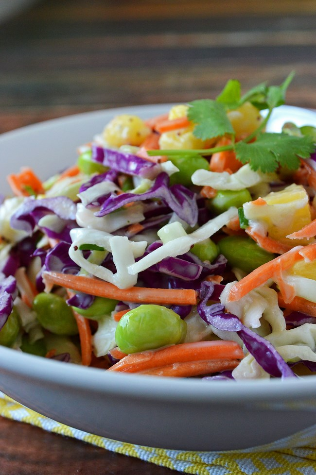 A gluten free cool crisp slaw made with juicy bits of fresh pineapple and sprinkled with chopped cilantro and a squeeze of lime juice. Jazz it up with a little poppyseed dressing and some edamame for extra protein.
