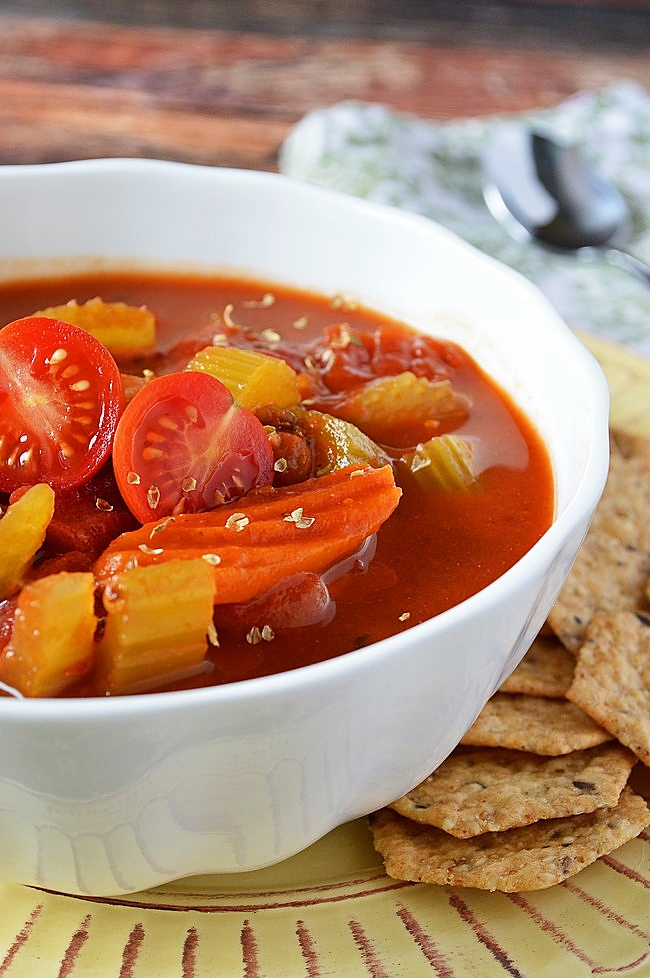 Made easy in the crockpot, this Gluten Free Tomato Basil Vegetable Soup takes canned tomato soup to the next level.