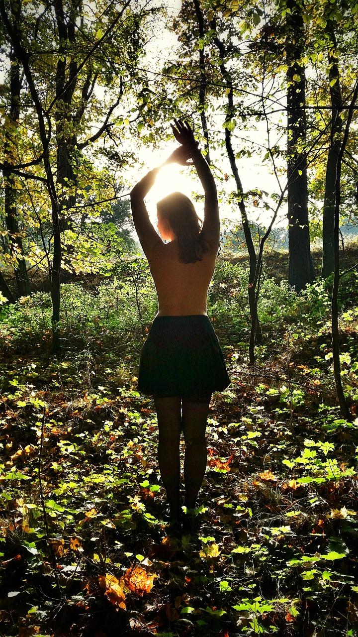 woman in woods sunlight