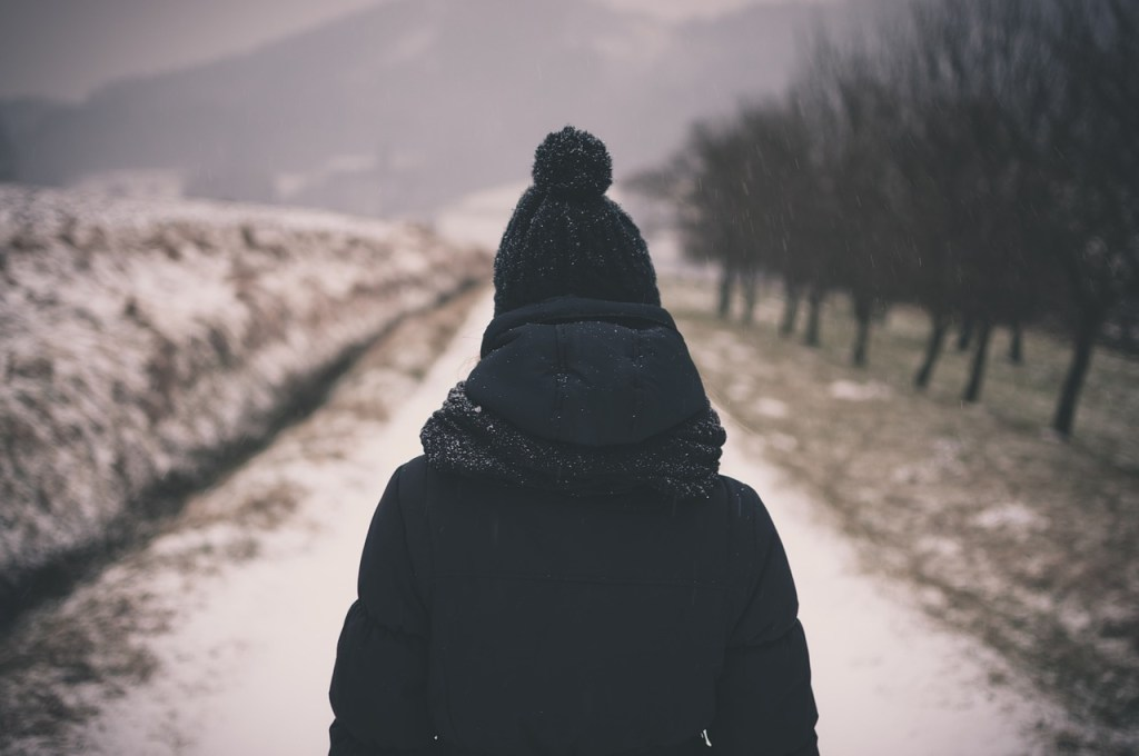 woman in winter clothes on road