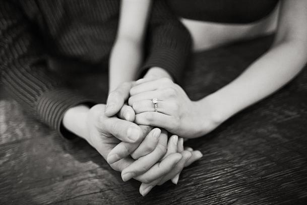 hand holding with diamond