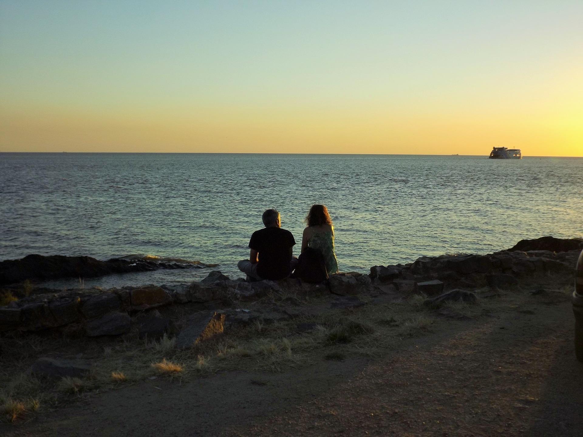 beach couple talk